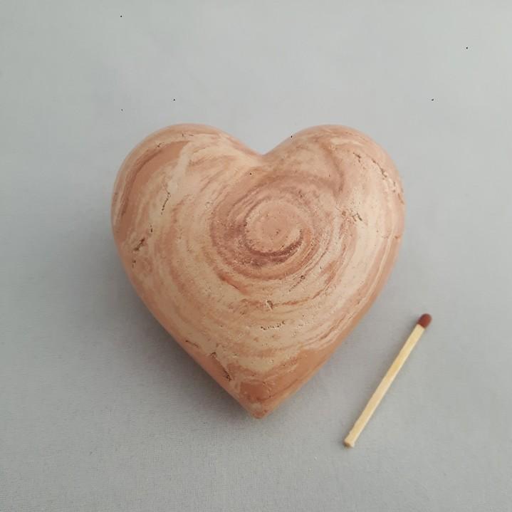 Urn hart surpriseklei middel